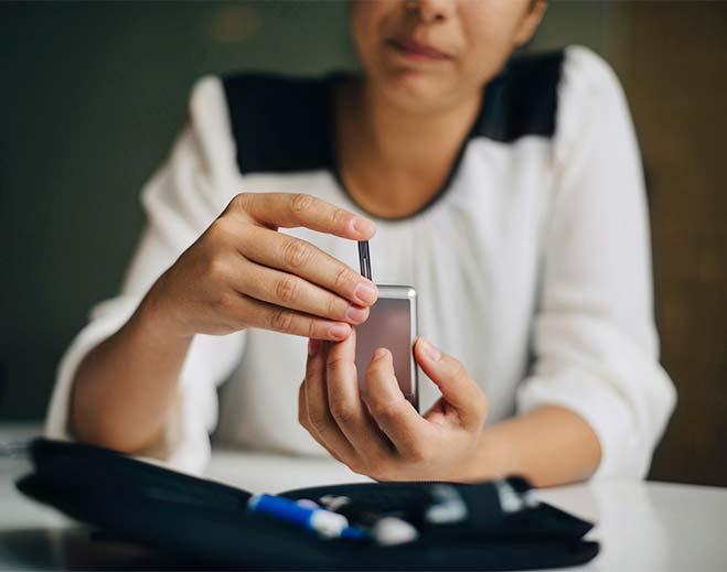 woman taking glucose test